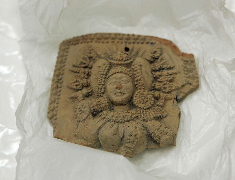 One of seven stolen artifacts that were on display at the Honolulu Museum of Art is shown in a secure room of the museum's basement, Tuesday, March 31, 2015 in Honolulu. An international investigation into antiquities looted from India and smuggled into the United States has taken authorities to the Honolulu Museum of Art, which handed over the rare artifacts that it acquired without museum officials realizing they were ill-gotten items. Agents from the U.S. Immigration and Customs Enforcement are taking the items back to New York and from there, eventually returning them to the government of India. (AP Photo/Caleb Jones)