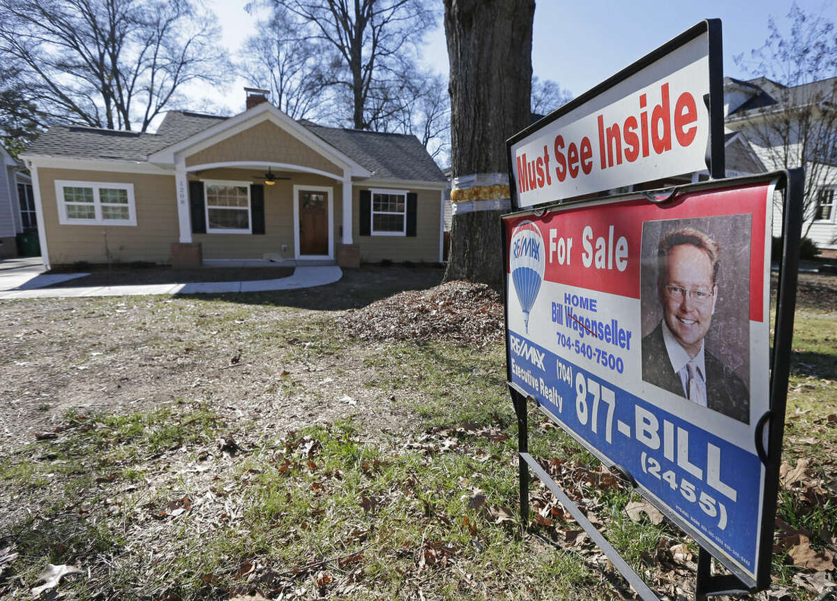 This Jan. 8 2015 photo shows a home for sale in Charlotte, N.C. Standard & Poor's releases S&P/Case-Shiller index of home prices for January on Tuesday, March 31, 2015. (AP Photo/Chuck Burton, File)