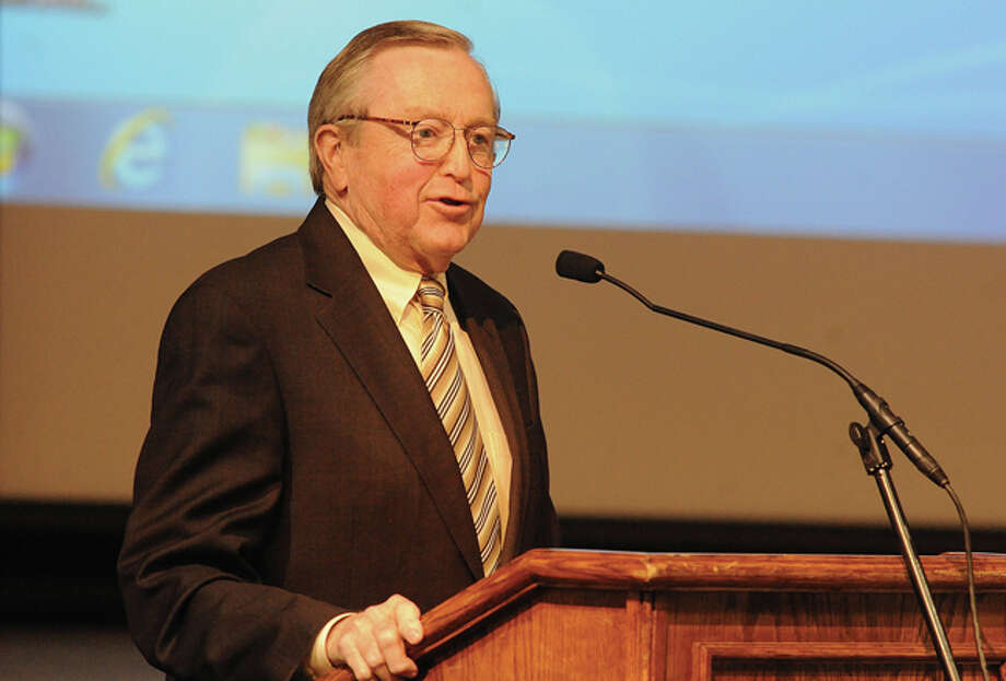 First Selectman Bill Brennan speaks Tuesday at the Middlebrook School auditorium during the 2014-15 municipal budget meeting.