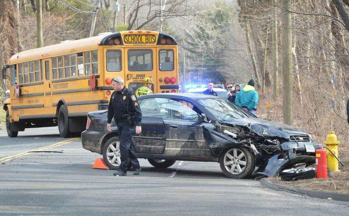 Hour Photo/Alex von Kleydorff Acccident scene involving multiple vehicles and a Norwalk Public School bus on the Wilton Westport line, Thursday at 3:30
