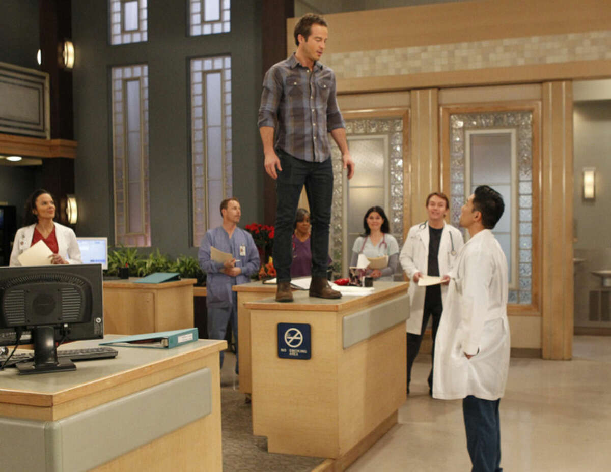 This photo provided by ABC shows Ryan Carnes, left, as Lucas, and Parry Shen as Brad, in a scene from