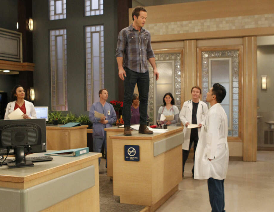 "This photo provided by ABC shows Ryan Carnes, left, as Lucas, and Parry Shen as Brad, in a scene from ""General Hospital,"" on ABC. The daytime show airs Monday-Friday (3:00 p.m. - 4:00 p.m., ET) on the ABC Television Network. ABC's ""General Hospital"" earned a leading 28 nominations for the Daytime Emmy awards, with four of its stars competing for honors as top actor and actress. (AP Photo/ABC, Rick Rowell)"