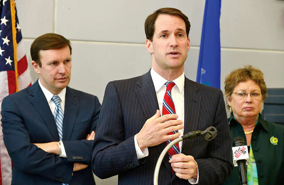 Hour photo / Erik Trautmann Congressman Jim Himes joins Senator Chris Murphy who hosted a press conference regarding the Northeast Corridor Commuter and Intercity Rail Cost Allocation Policy. Congressman Jim Himes and Murphy spoke on the Commission's plan to generate transportation funds for Connecticut and clarify Amtrak's responsibilities for regional states.