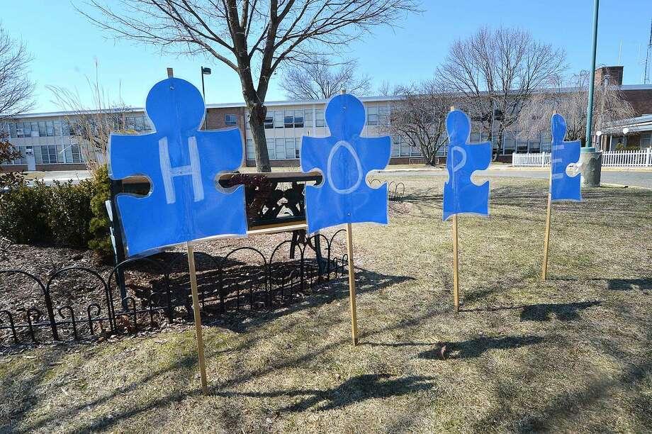 Hour Photo/Alex von Kleydorff Sign of hope in front of West Rocks School, part of World Autism Awareness Day.