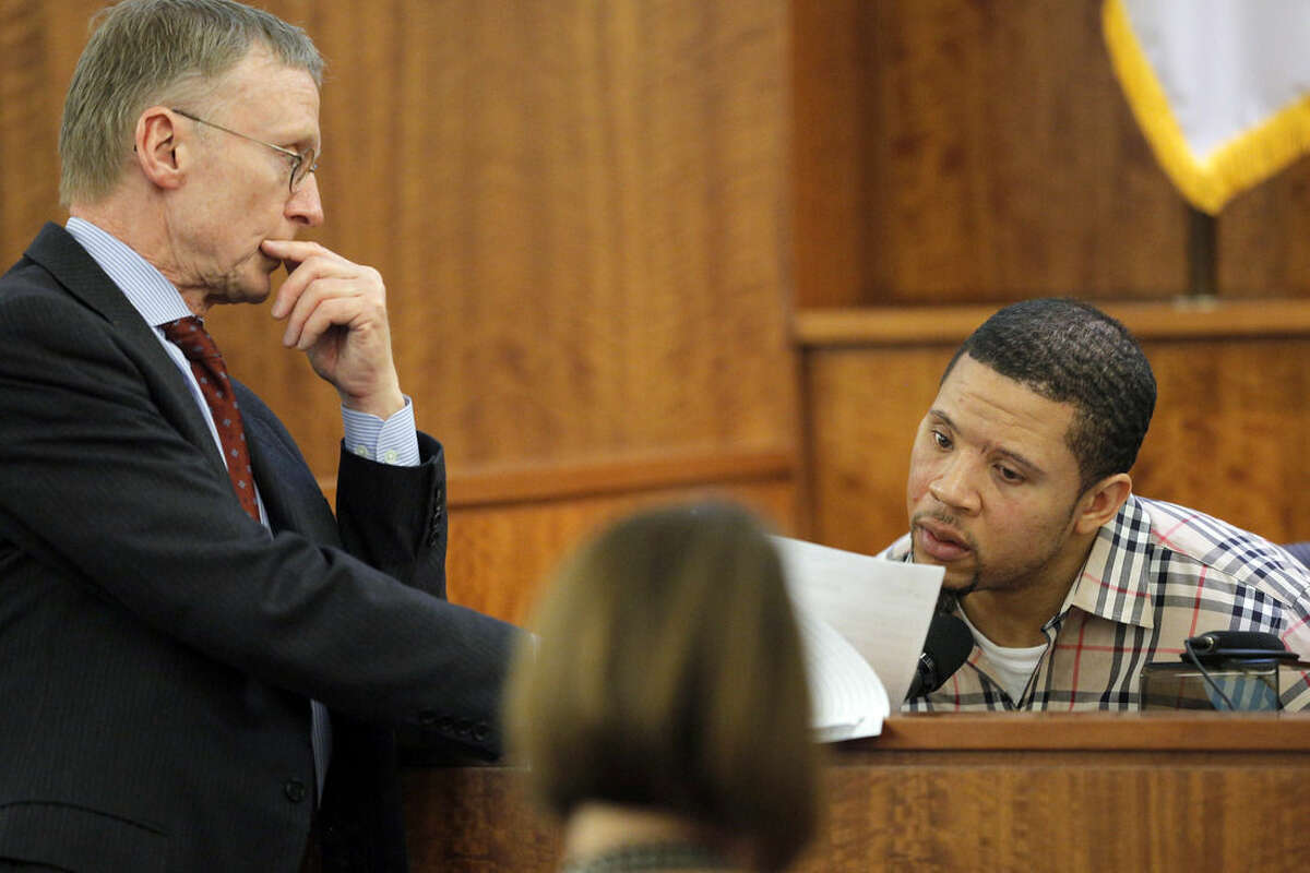 Defense attorney Charles Rankin, left, cross examines prosecution witness Alexander Bradley during former New England Patriots football player Aaron Hernandez's murder trial, Wednesday, April 1, 2015, at Bristol County Superior Court in Fall River, Mass. Hernandez is accused of killing Odin Lloyd in June 2013. (AP Photo/Brian Snyder, Pool)