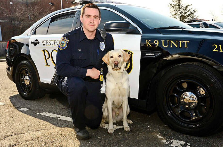 "Hour photo / Erik Trautmann Westport officer James Baker will pose with his new K9 ""Chase."" The department purchased Chase in December, but are hoping to raise money and be reimbursed through a Go Fund Me account. Chase will be certified mid-April and be the community service/narcotics dog."