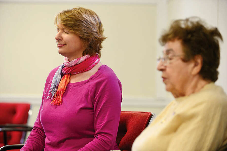 Hour photo / Erik Trautmann Beatrix winter teaches seniors meditation as part of a class at the Norwalk Senior Center.