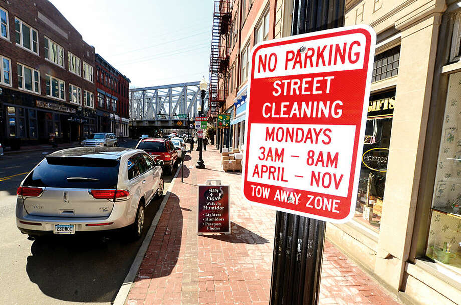 Hour photo / Erik Trautmann Starting April 6, sweeping will be done every Monday, from 3 to 8 a.m., in the SoNo and Wall Street business districts. Permanant signs will be installed at key locations in both areas.