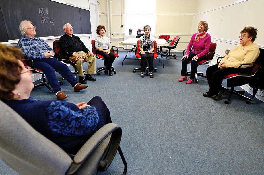 Hour photo / Erik Trautmann Seniors practice meditation as part of a class at the Norwalk Senior Center.
