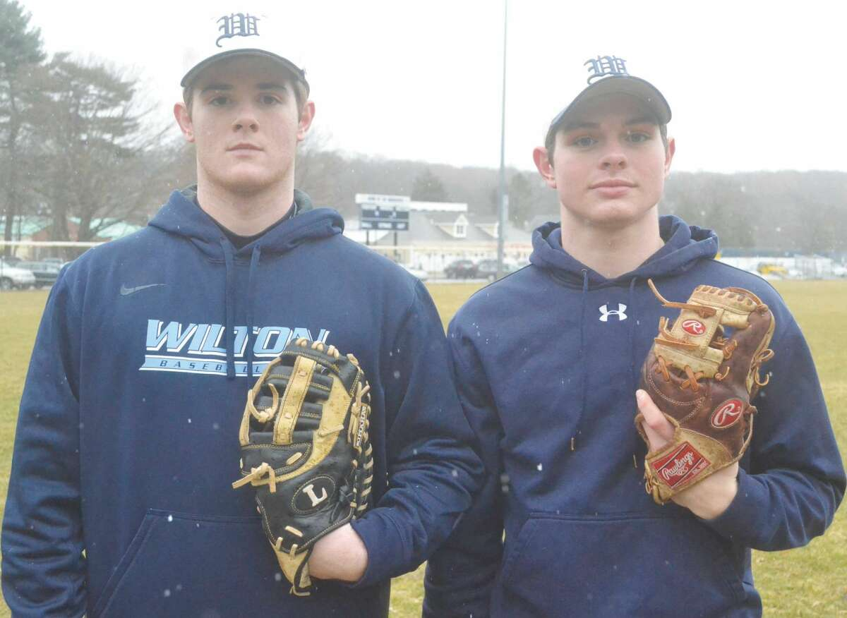 Wilton baseball captains Alex Jacobson, left, and Jackson Ward are hoping to lead the Warriors to a successful season.(Pete Paguaga/Hour photo)