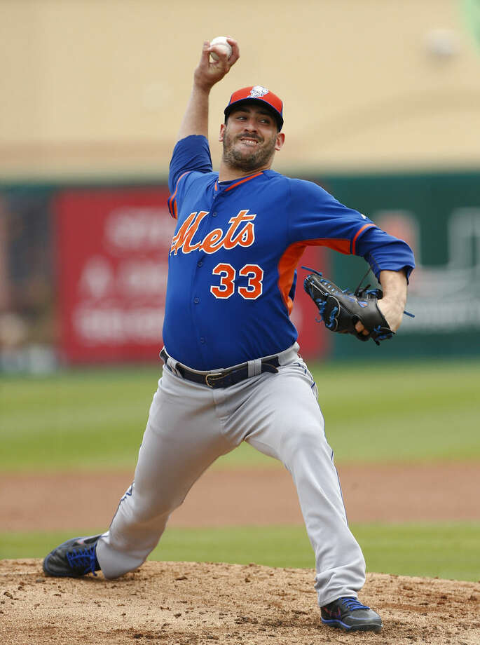 New York Mets starting pitcher Matt Harvey (33) works in the second inning of an exhibition spring training baseball game against the St. Louis Cardinals Thursday, April 2, 2015, in Jupiter, Fla. (AP Photo/John Bazemore)