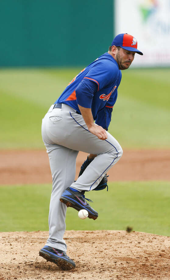 New York Mets starting pitcher Matt Harvey (33) tries to knock down a ball hit to him by St. Louis Cardinals' Jon Jay for a base hit in the third inning of an exhibition spring training baseball game Thursday, April 2, 2015, in Jupiter, Fla. (AP Photo/John Bazemore)