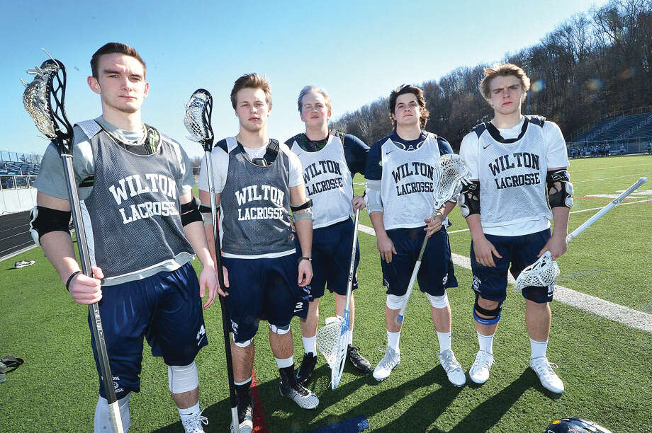 Wilton lacrosse captains, from left, Jack Dexter Tyler Mirabile, Jameson Hill, Reid Melillo and Christian Hansson hope to lead the Warriors back to the postseason.(Hour Photo/Alex von Kleydorff)