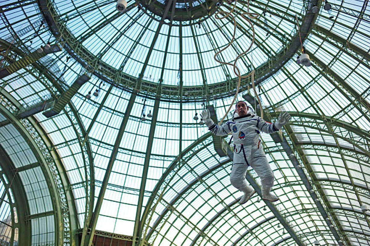 Chinese artist Li Wei performs in the Grand Palais during the Paris Art Fair, in Paris, Thursday, March 27, 2014. Art Paris Art Fair, which runs from the 27th to the 30th of March 2014, brings together some 140 galleries from 20 countries under the dome of the Grand Palais. (AP Photo/Thibault Camus)
