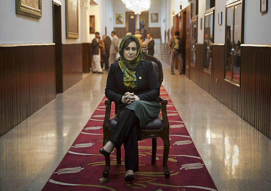 "In this Wednesday, March 26, 2014 photo, Afghan lawmaker Hamida Ahmadzai, who represents Afghanistan's colorful Kuchi, poses for a picture inside the Afghan parliament in Kabul, Afghanistan. ""In our Parliament we have 69 women, that is a large number, bigger even than European parliaments,"" Hamida says. (AP Photo/Anja Niedringhaus)"