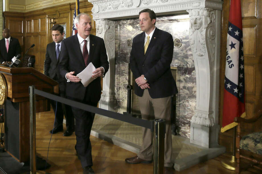 Arkansas Gov. Asa Hutchinson, center, walks between Sen. Jonathan Dismang, R-Beebe, left, and House Speaker Rep. Jeremy Gillam, R-Judsonia, after a news conference at the state Capitol in Little Rock, Ark., Wednesday, April 1, 2015. Hutchinson on Wednesday called for changes to a religious objection measure facing a backlash from businesses and gay rights groups, saying it wasn't intended to sanction discrimination based on sexual orientation. (AP Photo/Danny Johnston)