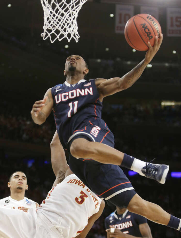 Connecticut's Ryan Boatright goes up for a shot over Iowa State's Melvin Ejim during the second half in a regional semifinal at the NCAA men's college basketball tournament Friday, March 28, 2014, in New York. (AP Photo/Frank Franklin II)