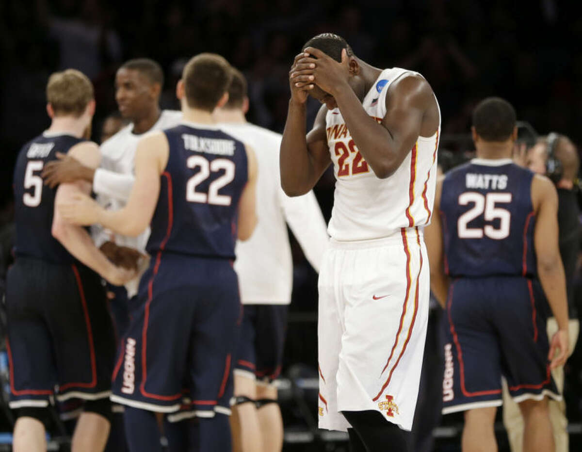 Iowa State's Dustin Hogue reacts after his team lost 81-76 to Connecticut in a regional semifinal of the NCAA men's college basketball tournament Friday, March 28, 2014, in New York. (AP Photo/Seth Wenig)