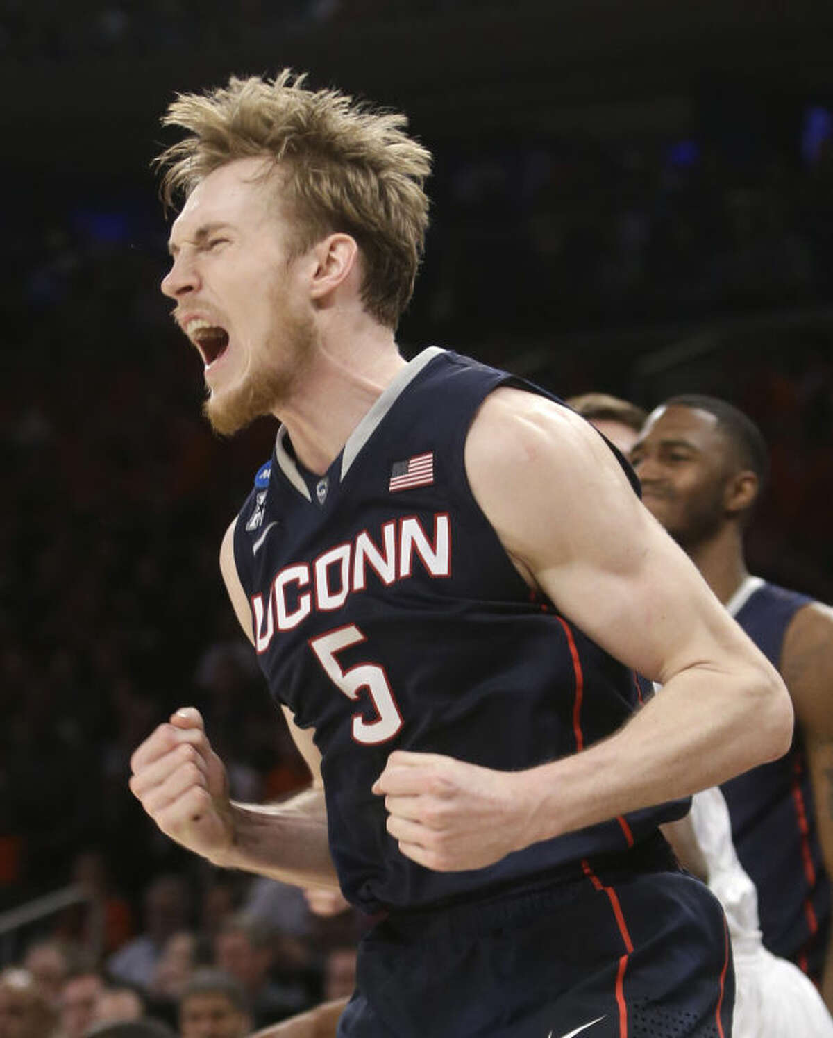 Connecticut's Niels Giffey exults during the second half in a regional semifinal against Iowa State in the NCAA men's college basketball tournament Friday, March 28, 2014, in New York. Connecticut won 81-76. (AP Photo/Frank Franklin II)