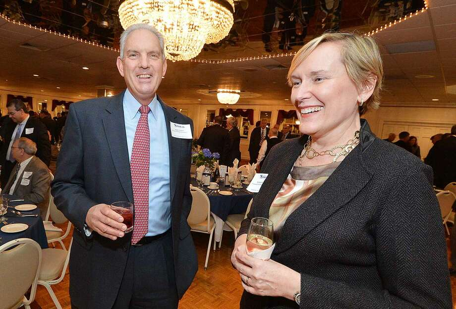 Hour Photo/Alex von Kleydorff Incoming Chairman Terry Polley and outgoing Chairman Mike Sutton talks with guests during The Greater Norwalk Chamber of Commerce 126th Annual Dinner