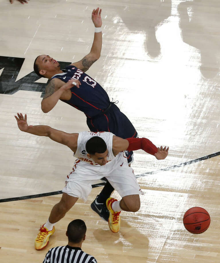 Connecticut's Shabazz Napier, top, falls near Iowa State's Naz Long during the second half in a regional semifinal of the NCAA men's college basketball tournament Friday, March 28, 2014 in New York. (AP Photo/Julio Cortez)