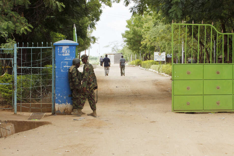 Members of Kenya Defense Forces stand guard at the Garissa University College in Garissa, northeastern Kenya, Friday, April 3, 2015. Al-Shabab gunmen rampaged through the university at dawn Thursday, killing 147 people in the group's deadliest attack in the East African country. (AP Photo/Khalil Senosi)