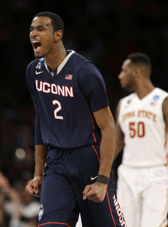 Connecticut's DeAndre Daniels exults during the second half in a regional semifinal of the NCAA men's college basketball tournament Friday, March 28, 2014 in New York. Iowa State's DeAndre Kane is at right. (AP Photo/Seth Wenig)