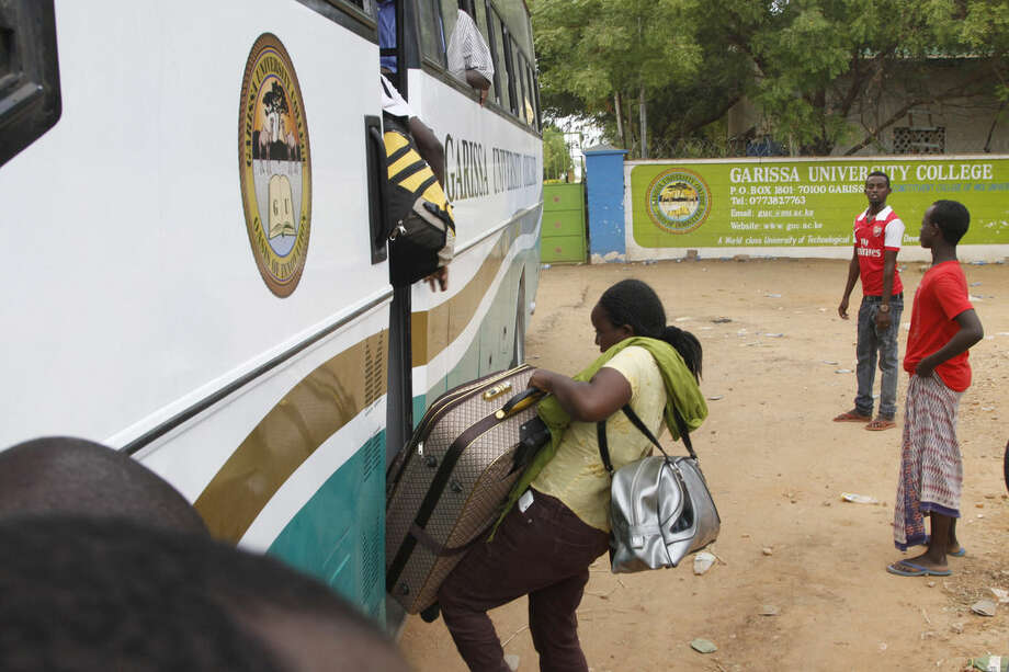 A university student gets on a bus at the gate of the Garissa University College in Garissa, northeastern Kenya, Friday, April 3, 2015. Al-Shabab gunmen rampaged through the university at dawn Thursday, killing 147 people in the group's deadliest attack in the East African country. (AP Photo/Khalil Senosi)