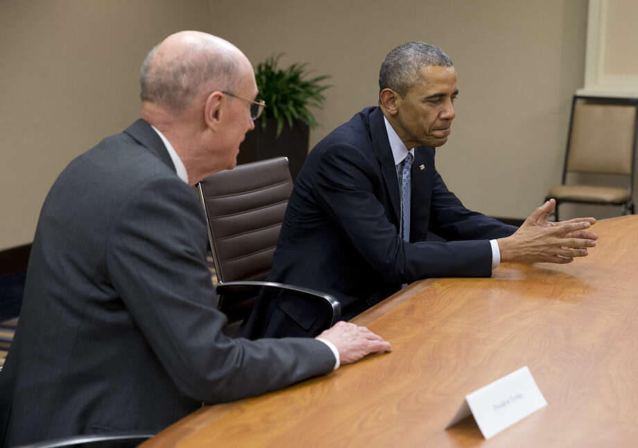 President Barack Obama meets with leaders of the Church of Jesus Christ of Latter-day Saints, including President Henry Eyring, left, Thursday, April 2, 2015, in Salt Lake City. Upon arrival at his hotel in Salt Lake City, Obama went straight into a meeting with top leaders of the Church of Jesus Christ of Latter-day Saints. (AP Photo/Carolyn Kaster)
