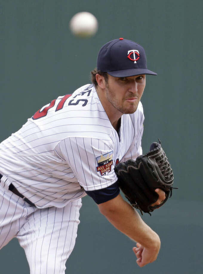 Minnesota Twins starting pitcher Phil Hughes (45) pitches in the first inning of an exhibition baseball game against the Boston Red Sox in Fort Myers, Fla., Friday, March 28, 2014. (AP Photo/Gerald Herbert)