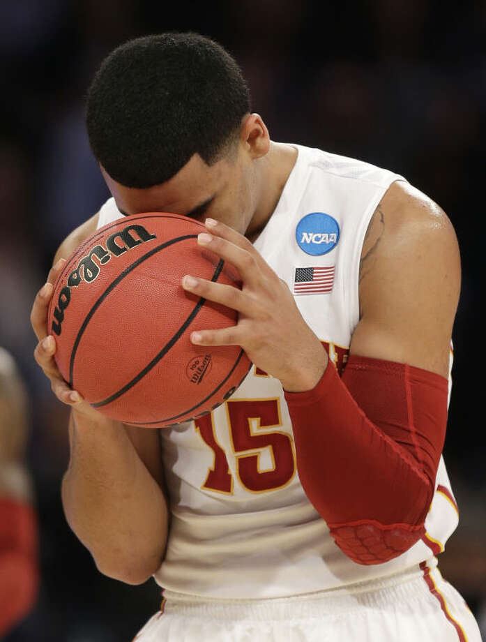 Iowa State's Naz Long holds the ball to his head during the second half in a regional semifinal against Connecticut at the NCAA mens' college basketball tournament, Friday, March 28, 2014 in New York. (AP Photo/Seth Wenig)