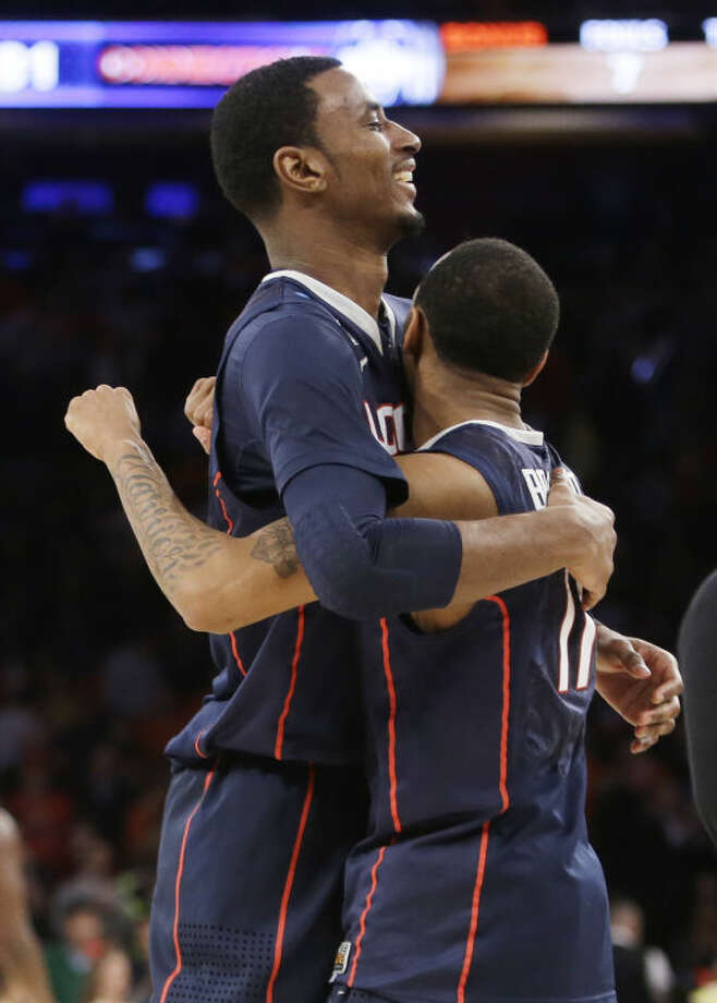 Connecticut's DeAndre Daniels, left, hugs teammate Ryan Boatright after Connecticut defeated Iowa State 81-76 in a regional semifinal of the NCAA men's college basketball tournament Friday, March 28, 2014, in New York. (AP Photo/Frank Franklin II)