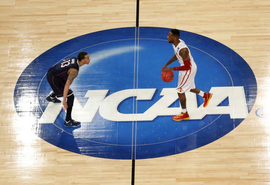 Iowa State's DeAndre Kane, right, dribbles toward Connecticut's Shabazz Napier during the second half in a regional semifinal in the NCAA men's college basketball tournament, Friday, March 28, 2014, in New York. (AP Photo/Julio Cortez)