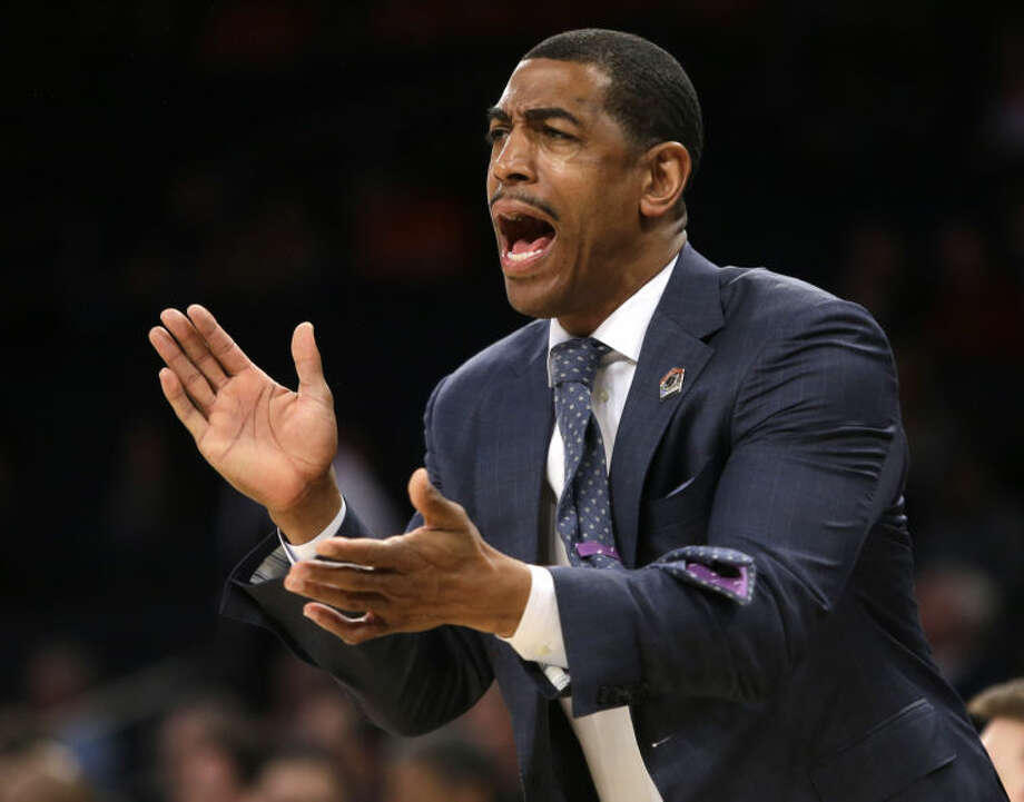 Connecticut coach Kevin Ollie shouts instructions during the first half in a regional semifinal against Iowa State in the NCAA men's college basketball tournament Friday, March 28, 2014, in New York. (AP Photo/Frank Franklin II)