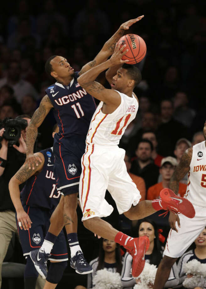 Connecticut's Ryan Boatright, left, reaches to block a pass by Iowa State's Monte Morris during the first half in a regional semifinal of the NCAA men's college basketball tournament Friday, March 28, 2014, in New York. (AP Photo/Seth Wenig)