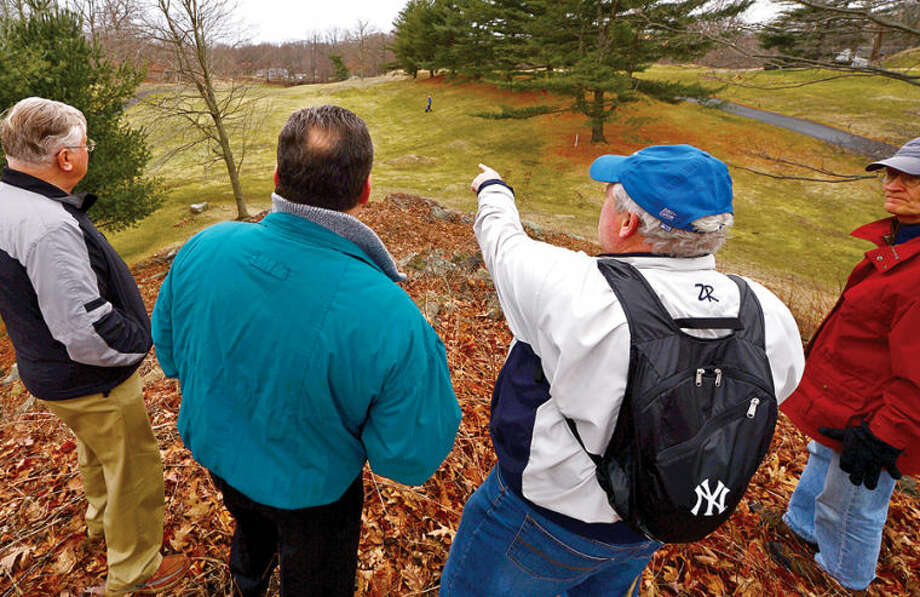 Hour photo / Erik Trautmann Oak Hills Park Authority member Ernie Desrochers points out area covered by plan which for a new driving range during a public tour Saturday at Oak Hills Park.