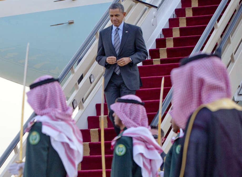 In this March 28, 2014, photo, President Barack Obama walks down the stairs of Air Force One during his arrival at King Khalid International airport in Riyadh, Saudi Arabia. From the heart of Europe to the expanse of Saudi Arabia's desert, Obama's weeklong overseas trip amounted to a reassurance tour for stalwart, but sometimes skeptical, American allies. At a time when Obama is grappling with crises and conflict in both Europe and the Middle East, the four-country swing also served as a reminder that even those longtime partners still need some personal attention from the president. (AP Photo/Pablo Martinez Monsivais)