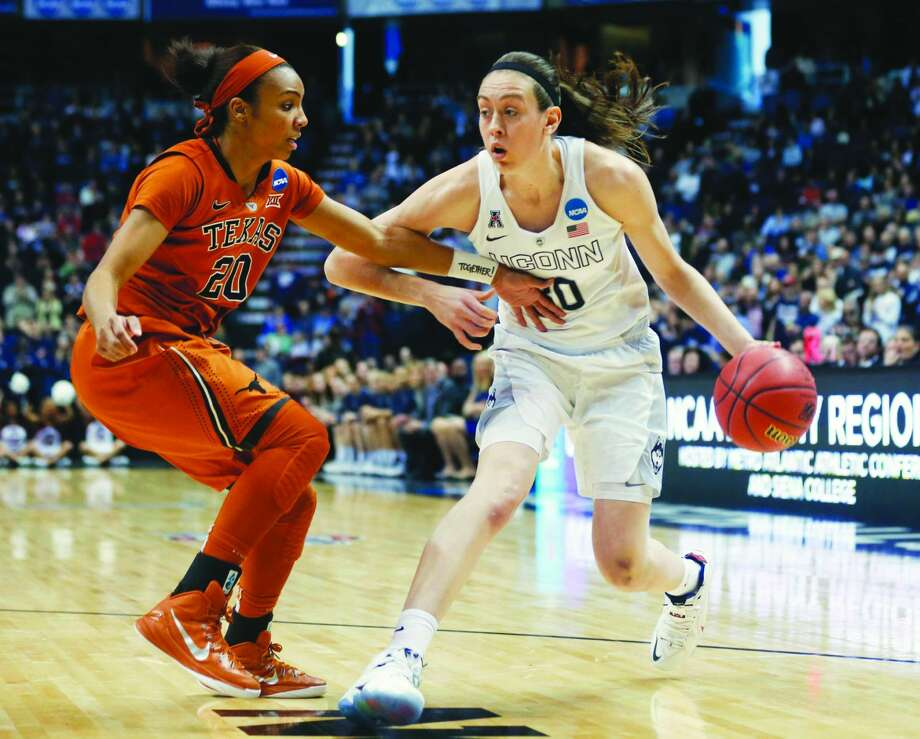 FILE - In this March 28, 2015 file photo, Connecticut forward Breanna Stewart (30) drives against Texas guard Brianna Taylor (20) during the first half of a women's college basketball regional semifinal game in the NCAA Tournament in Albany, N.Y. (AP Photo/Mike Groll, File)