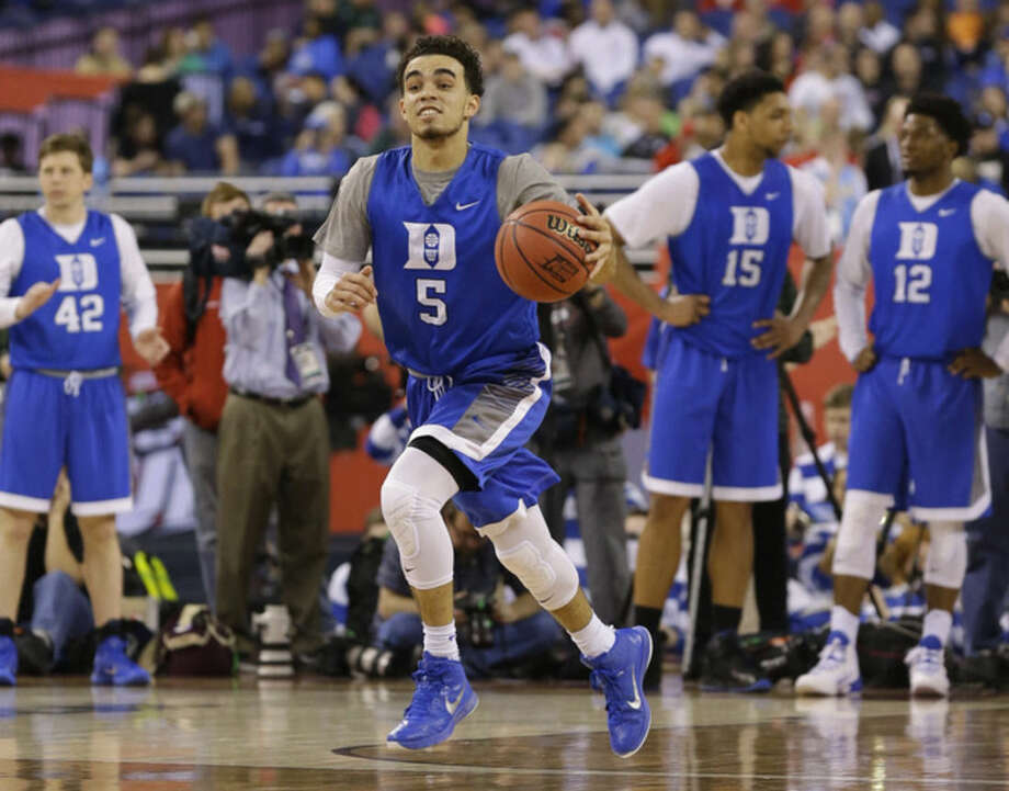 Duke's Tyus Jones runs a drill during a practice session for the NCAA Final Four tournament college basketball semifinal game Friday, April 3, 2015, in Indianapolis. Duke plays Michigan State on Saturday. (AP Photo/Michael Conroy)