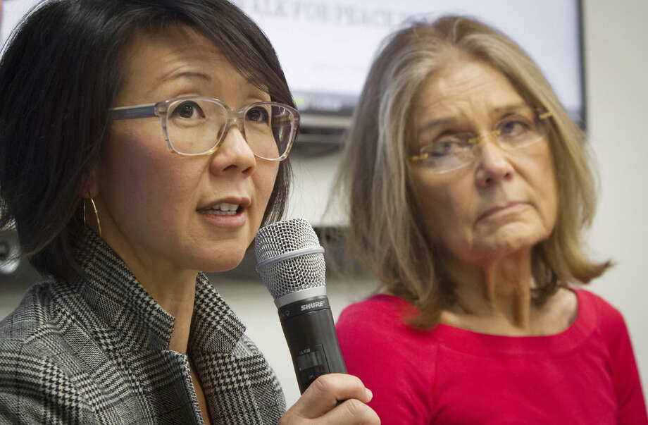 "FILE - Organizers of the effort called WomenCrossDMZ.org, including lead coordinator Christine Ahn, left, and honorary co-chair Gloria Steinem, right, hold a United Nations news conference announcing plans for a rare and risky women's walk across the demilitarized zone between North and South Korea to call for reunification, in this March 11, 2015 file photo. Ahn said in an email Friday April 3, 2015 they have Pyongyang's cooperation and support."". (AP Photo/Bebeto Matthews, File)"