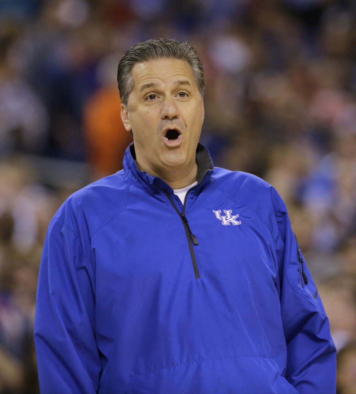Kentucky head coach John Calipari reacts during a practice session for the NCAA Final Four tournament college basketball semifinal game Friday, April 3, 2015, in Indianapolis. Kentucky plays Wisconsin on Saturday. (AP Photo/David J. Phillip)