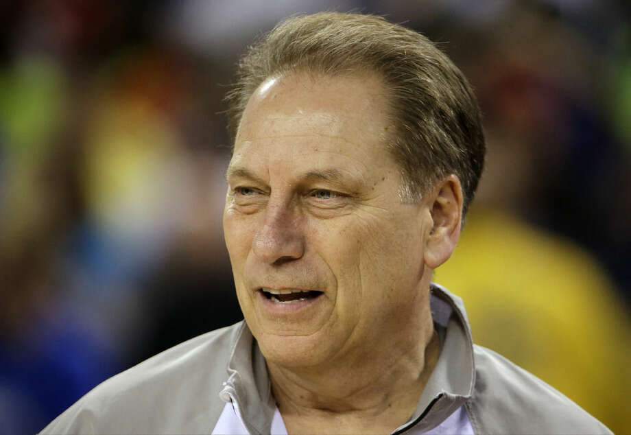 Michigan State head coach Tom Izzo watches his players during a practice session for the NCAA Final Four tournament college basketball semifinal game Friday, April 3, 2015, in Indianapolis. Michigan State plays Duke on Saturday. (AP Photo/David J. Phillip)