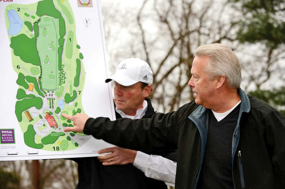 Hour photo / Erik Trautmann Oak Hills Park Authority hosts Total Driving Range Solutions Jim Downing as he gives an Informational tour of area covered by the plan for a new driving range Saturday at Oak Hills Park.