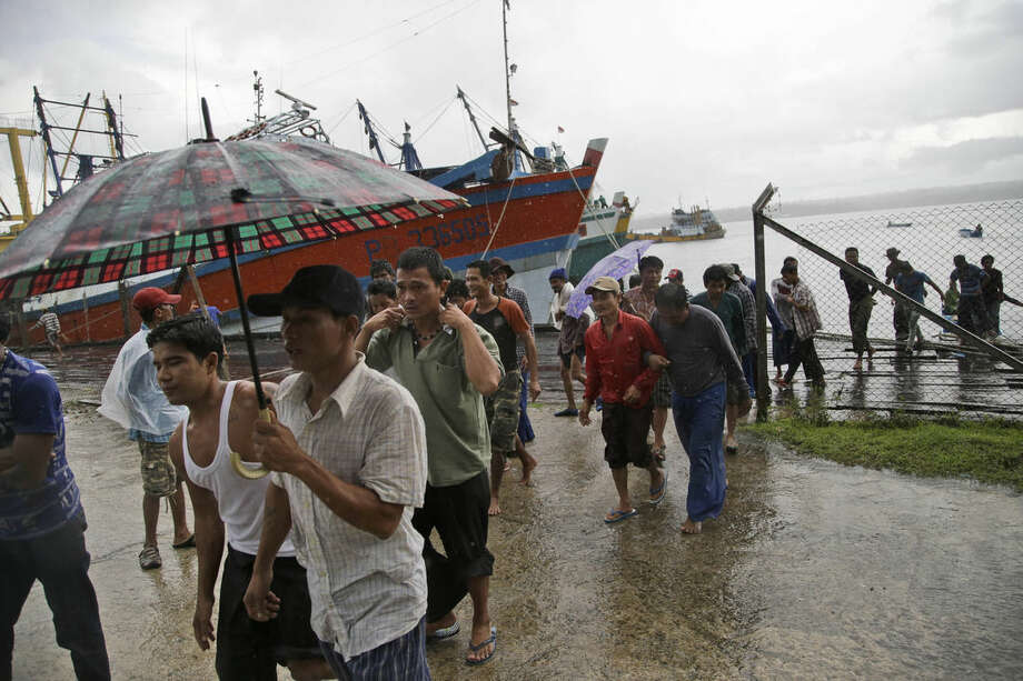 Burmese fishermen arrive at the compound of Pusaka Benjina Resources to report themselves for departure to leave the fishing company in Benjina, Aru Islands, Indonesia, Friday, April 3, 2015. Hundreds of foreign fishermen on Friday rushed at the chance to be rescued from the isolated island where an Associated Press report revealed slavery runs rampant in the industry. Indonesian officials investigating abuses offered to take them out of concern for the men's safety. (AP Photo/Dita Alangkara)
