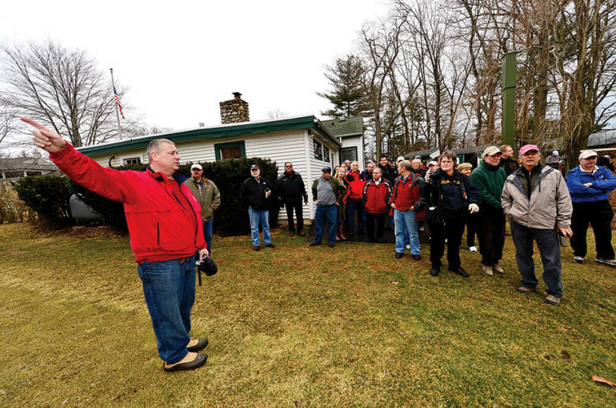 Hour photo / Erik Trautmann Oak Hills Park Authority chair Clyde Mount hosts an Informational tour of area covered by the plan for a new driving range Saturday at Oak Hills Park.