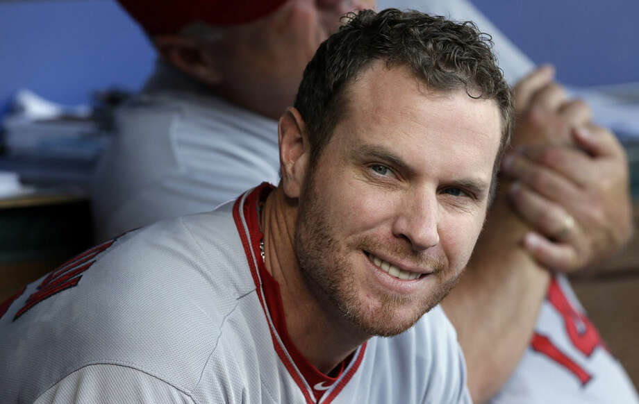 FILE - This July 12, 2014, file photo shows Los Angeles Angels' Josh Hamilton in the dugout during a baseball game against the Texas Rangers in Arlington, Texas. An arbitrator has ruled Josh Hamilton will not be disciplined by Major League Baseball for violating his treatment program. MLB said Friday, April 3, 2015, it disagreed with the decision. (AP Photo/LM Otero, File)