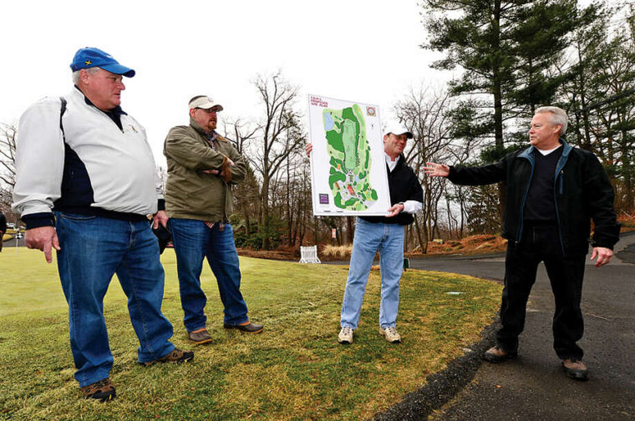 Hour photo / Erik Trautmann Oak Hills Park Authority members Ernie Desrochers, Bill Waters and David Hollar listen to Total Driving Range Solutions' Jim Downing during an Informational tour of area covered by the plan for a new driving range Saturday at Oak Hills Park.