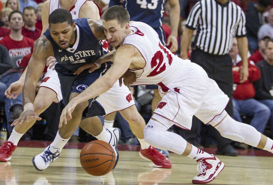 FILE - In this Dec. 31, 2014, file photo, Wisconsin's Josh Gasser, right, knocks the ball loose from Penn State's D.J. Newbill during the first half of an NCAA college basketball gamein Madison, Wis. Good teams need players who do the little things _ the ones who dive for loose balls, draw charges and throw their bodies into shutting down an opponent's best scorer. At No. 5 Wisconsin, that guy is Josh Gasser. (AP Photo/Andy Manis, File)