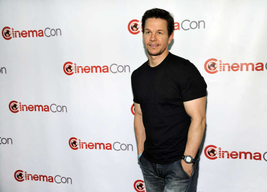 """FILE - In this Monday, March 24, 2014 file photo, Mark Wahlberg, a cast member in the upcoming film """"Transformers: Age of Extinction,"""" poses at the Opening Night Presentation from Paramount Pictures at CinemaCon 2014, in Las Vegas. The 27th annual Kids' Choice Awards are back with some of today's top stars among the top nominees, including Katy Perry, Jennifer Lawrence and Sandra Bullock. Mark Wahlberg hosts and Aloe Blacc and American Authors are scheduled to perform Saturday, March 29, 2014, in Los Angeles during the live broadcast that starts at 8 p.m. EDT on Nickelodeon. (Photo by Chris Pizzello/Invision/AP, file)"""