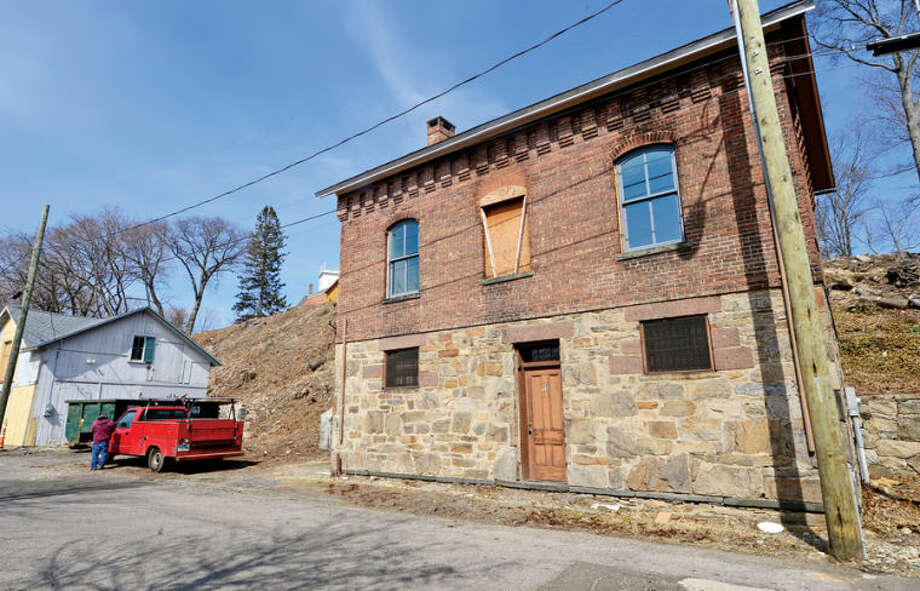 Hour photo / Erik Trautmann The Norwalk Historical Society and the Norwalk Historical Commission are begining restoration of fire-damaged Smith Street Jailhouse and nearby historic barn.